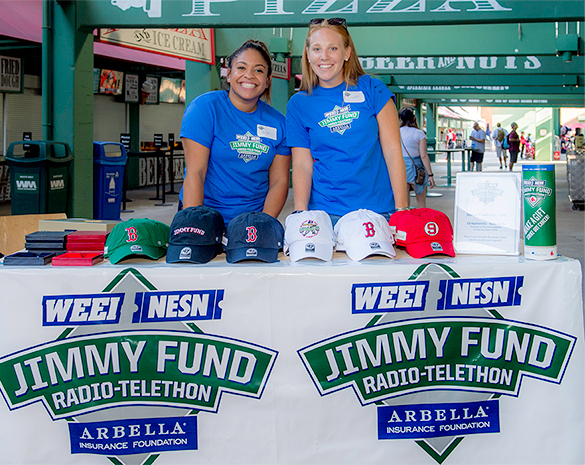 Volunteers sell hats to Jimmy Fund supporters