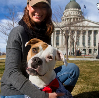 Lady with dog in front of the Capitol building