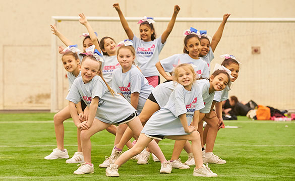 Cheer for Dana-Farber team posing at the New England cheerleader clinic