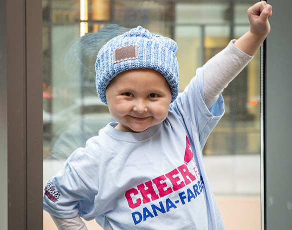Young Cheer for Dana Farber® cheerleader posing at Gillette Stadium