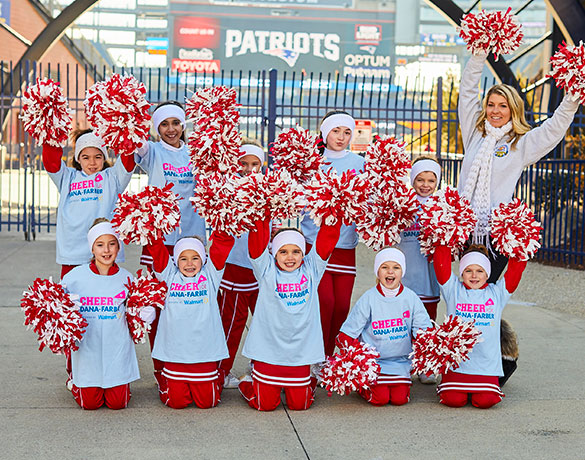 Cheer for Dana-Farber® team holding pom-poms at Gillette Stadium