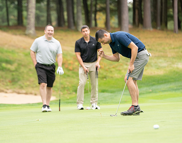 Golfers participate in the Jimmy Fund Golf Challenge