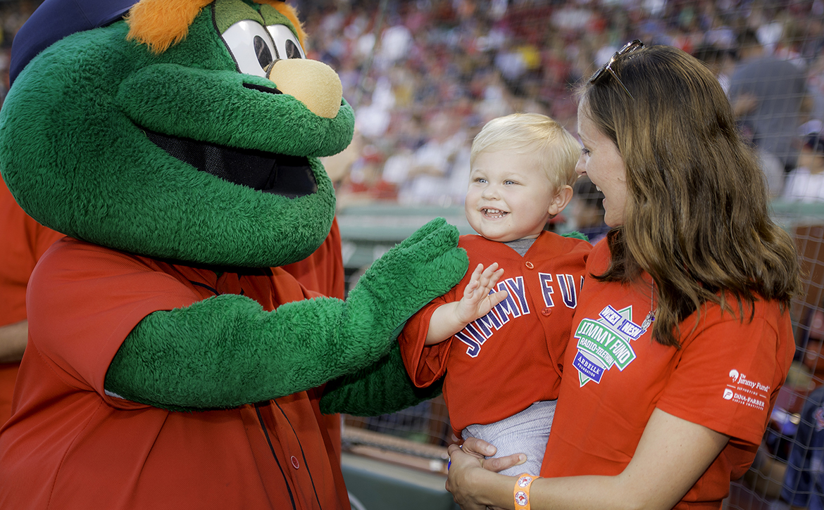 Young Dana-Farber patient with Wally the Green Monster