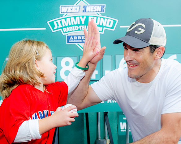 NHL player Brian Boyle high fives a young Dana-Farber patient