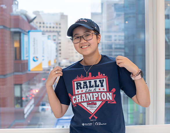 A Jimmy Fund clinic patient shows off her Rally t-shirt