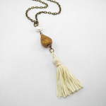 Click here for more information about Ivory Tassel and Vintage Brass Pendant