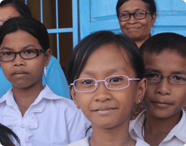 Class of young kids with glasses