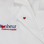 Click here for more information about Le Bonheur heart lapel pin